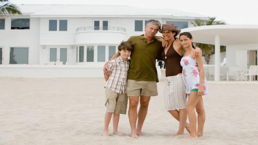 100310183-beach-house-family-gettyp.530x298